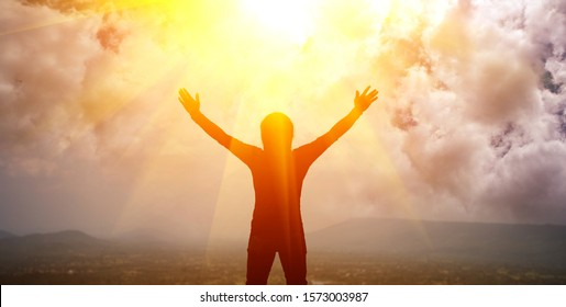 A man with both arms raised