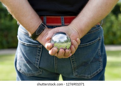 Man with a boule ball in his hand