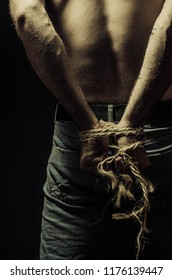 man is bound hands