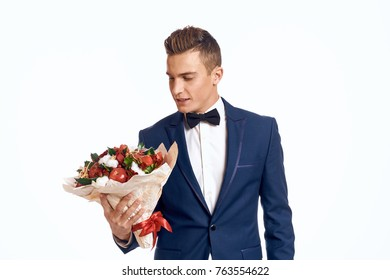 man with a bouquet of fruit on isolated background