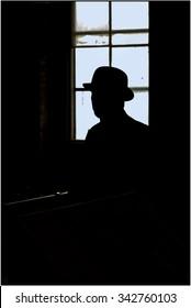 Man in bowler hat looking left