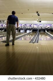 Man Bowling - focus on lanes