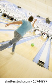 Man bowling, rear view