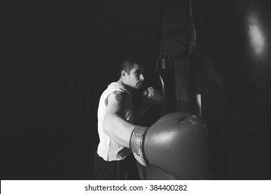 Man boxer at the gym. Male sports. Black and white image.