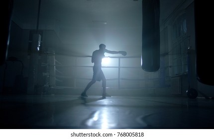 Man boxer training for a hard fight.