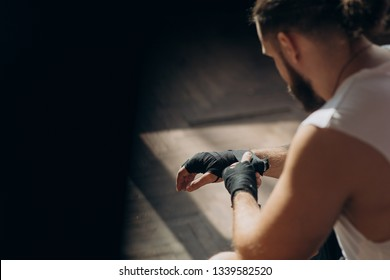 Man Boxer Wrapping Hands Getting Ready for a Fight. Wrapping Hands for Boxing Gloves