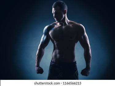 Man boxing. Young boxer fighter over black background