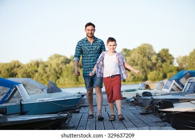 Man and boy fishing on the lake, Father and son fishing