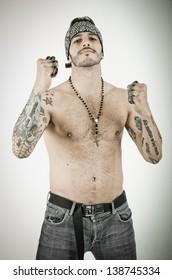 man with brass knuckles in grunge background