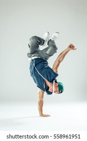 Man break dancer on white studio background