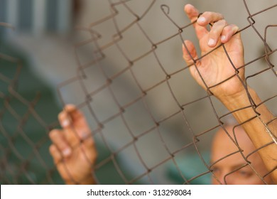 A man breaking down the fence. Immigration concept