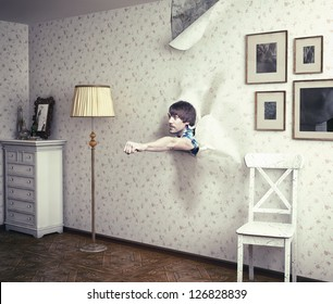 man breaking the room wall by  fist
