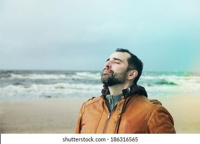 Man breathing free on the beach