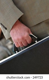 Man with briefcase closeup.