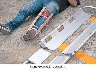 A Man broke his leg in an accident. splint medical equipment using to transport stretcher.