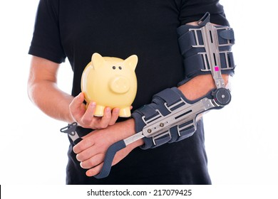 man with broken arm and piggy bank