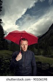 Man with broken umbrella being cranky