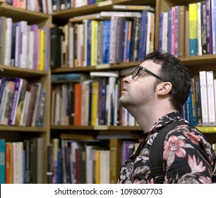 Man browsing antique books in a second hand bookshop