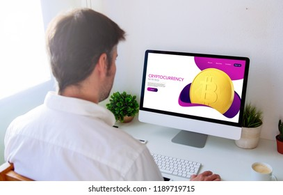 Man browsing cryptocurrency website on computer