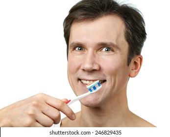 Man brushing his teeth on white background