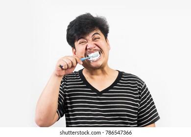 Man brushing teeth  brushing teeth before go to work.