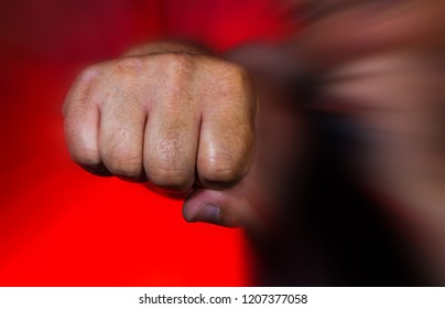 a man brutally hits with his fist