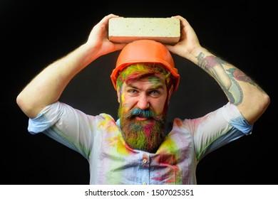 Man builder bricklayer in orange helmet. Civil engineer. Construction mason worker bricklayer. Prevent accident. Safety helmet. Prevent injury. Accident prevention. Safety at any time. Safety concept.