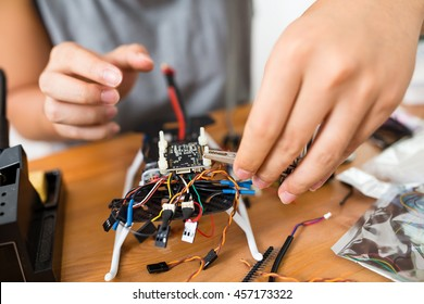 Man building a flying drone