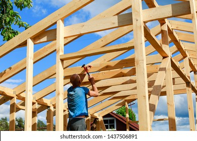 a man builds a house in the village