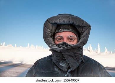 Man bundled in winter coat in Alaska