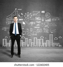man with business plan concept on wall