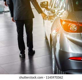 man business saleman open door car on street blurry background.For automotive automobile or transport transportation image