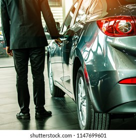 man business saleman open door car on street blurry background.For