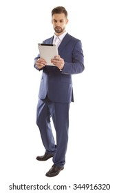 Man in a business style uses the tablet