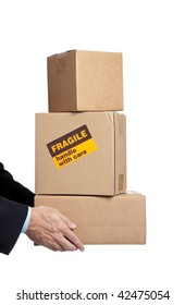 Man in a business suit holding boxes with a fragile sticker on it on a white background