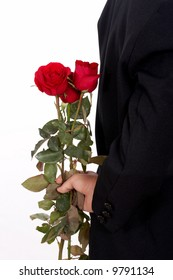 man in a business suit holding flowers