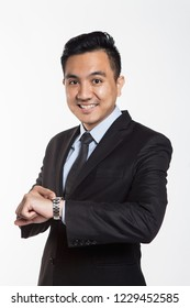 Man in business suit looking at his wrist watch
