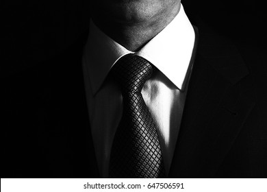 Man in business suit, business man on black background