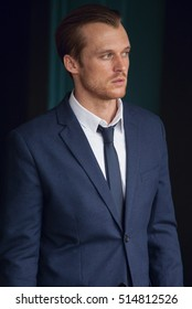 man in business suit on the studio