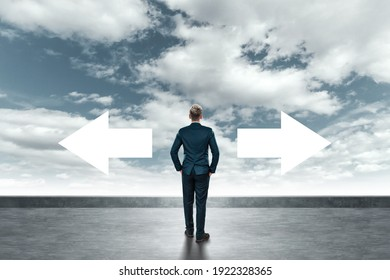 A man in a business suit stands and chooses the right path. Business concept, solution, development direction