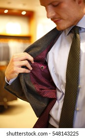man with business suite and tie