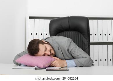 man businessman asleep at his desk