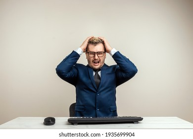 A man businessman is furious and angry at the computer, an office worker is going crazy. The concept of the village of botoreyka, fatigue, a difficult task, anxiety