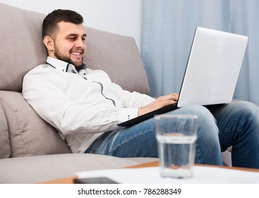 Man businessman is having productive day earning online at home