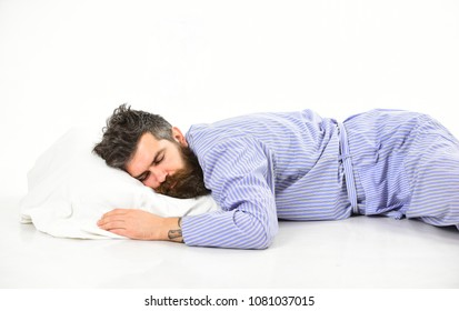 Man, businessman sleeps with banknote above head, white background. Dreaming of richness concept. Man on sleepy face lay on pillow, sleeps. Hipster with beard and mustache sleeping, dreaming of money.