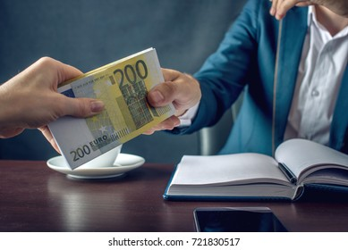 Man Businessman in suit takes the money hands. A bribe in the form of euro bills. The concept of corruption and bribery