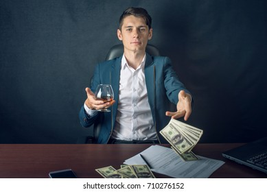 Man Businessman in suit throwing money in the form of hundred dollar bills. The concept of Investments and successful business