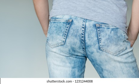man butt in jeans. nice buttocks in blue denim. male fashion