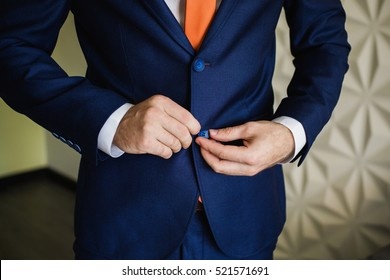 Man buttoning his jacket. Men's style. Professions. Preparing to work on meeting.