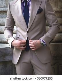 Man buttoning jacket
